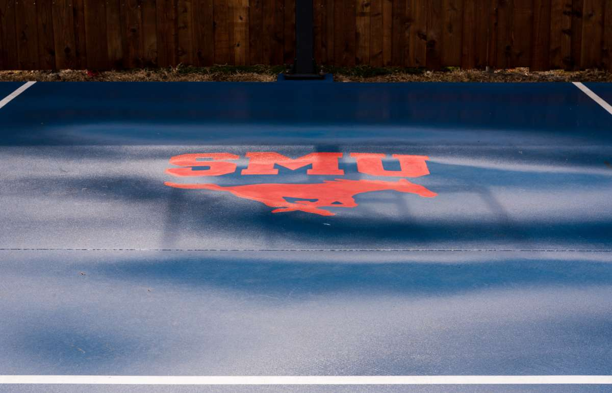Stained concrete SMU logo