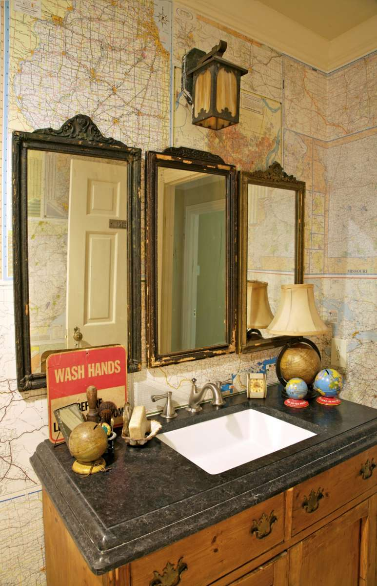 antique maps used as wallpaper in Richardson powder bath remodel