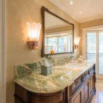 close up of onyx countertop on custom furniture vanity cabinet in preston hollow master bathroom remodel