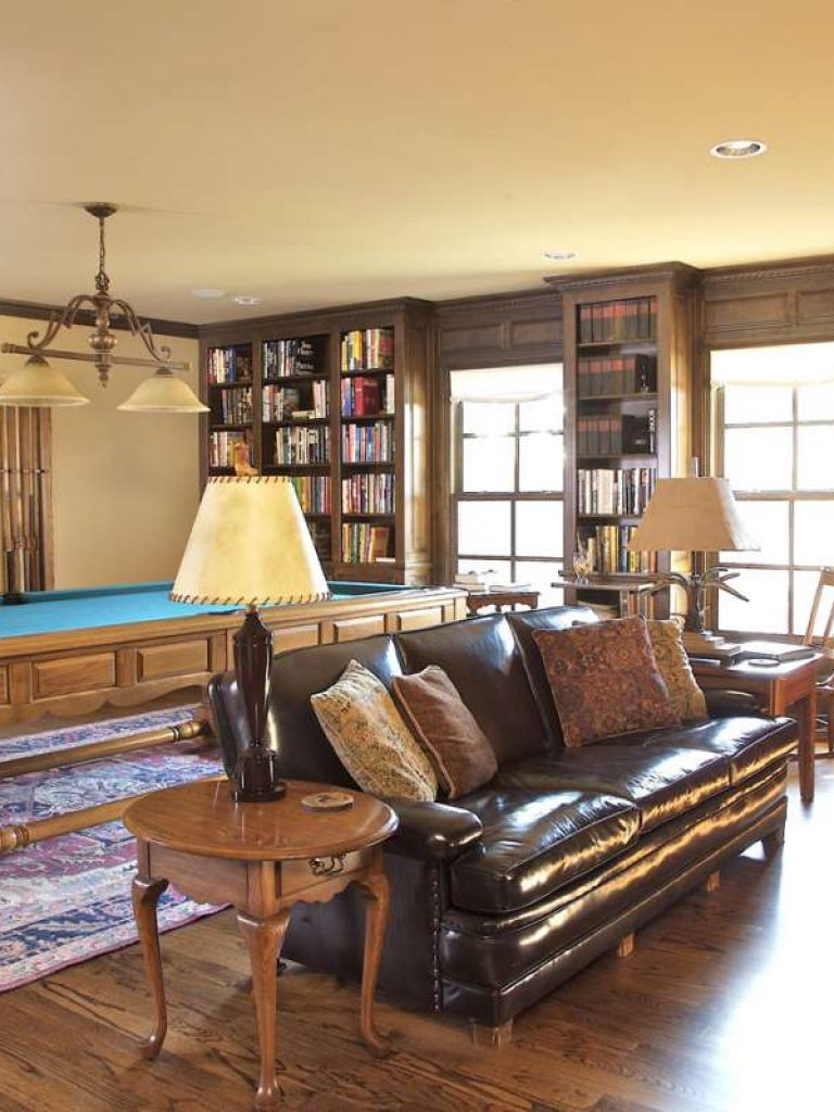 custom cabinets and pool table in family room of Dallas whole home remodel