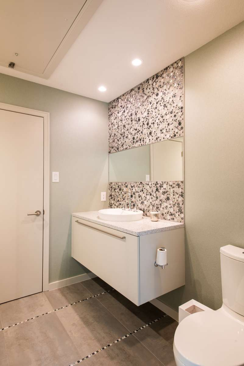 floating vanity in secondary bath of dallas whole house remodel