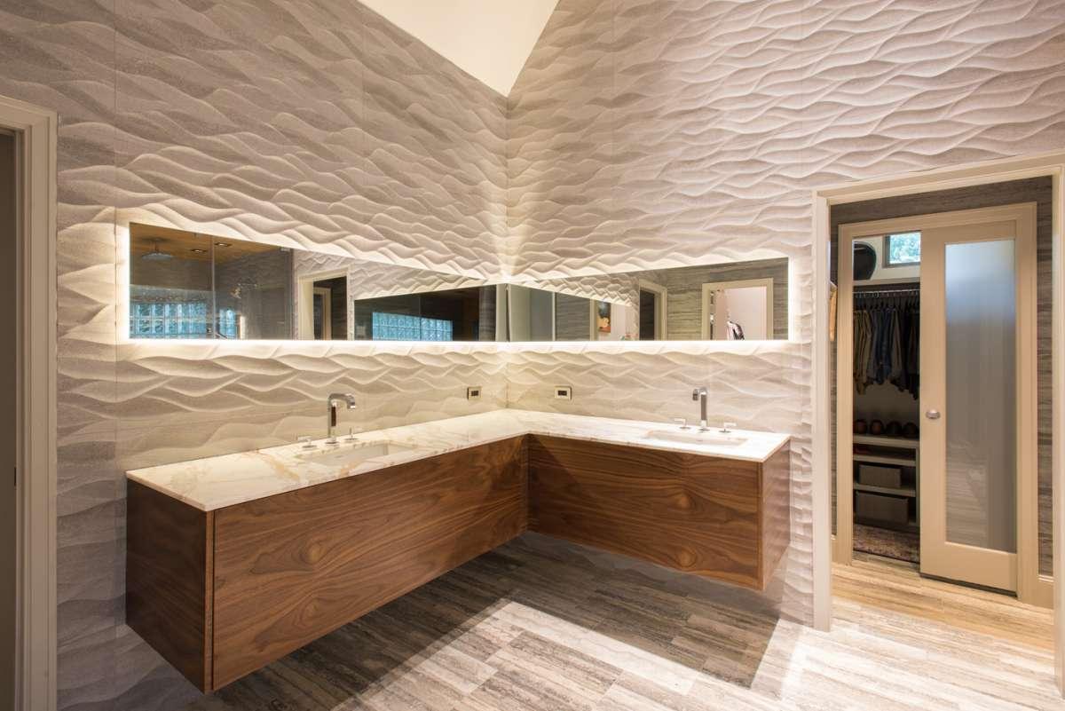 floating walnut vanity in master bathroom of dallas whole house remodel