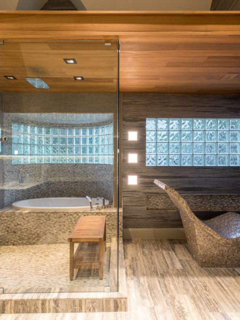 heated lounger and steam bath in master bathroom of dallas whole house remodel