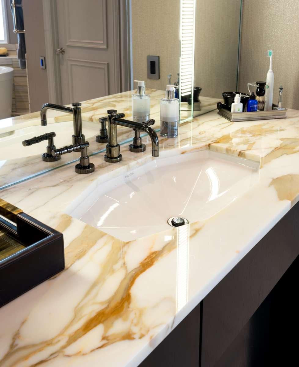 kallista sink in marble countertop of plano master bathroom remodel