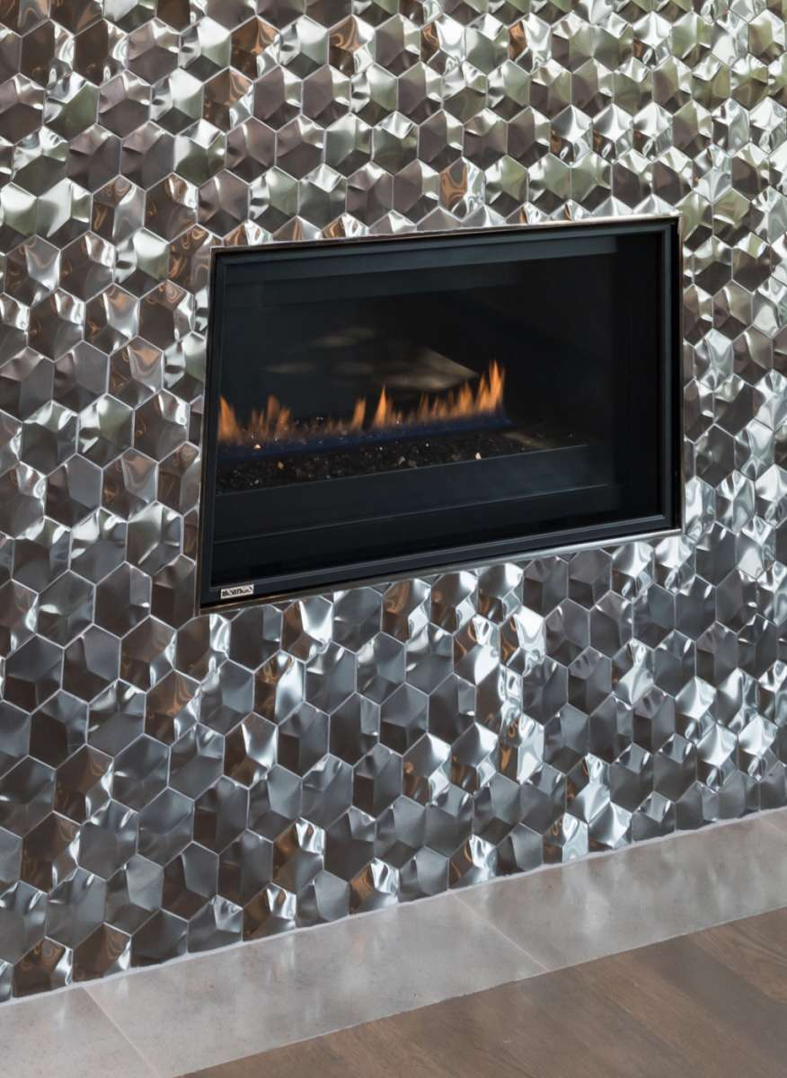 linear fireplace in stainless tile of plano master suite remodel