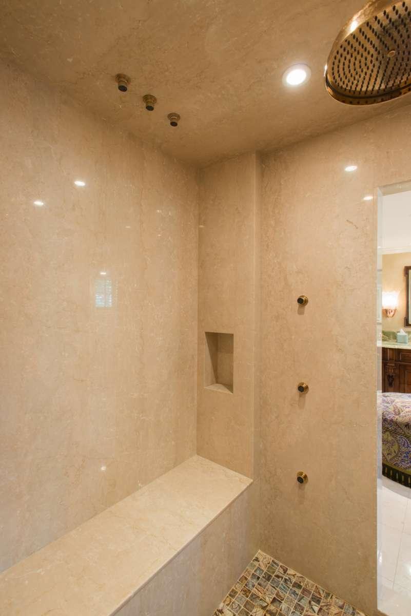 marble slab shower walls in preston hollow master bathroom remodel