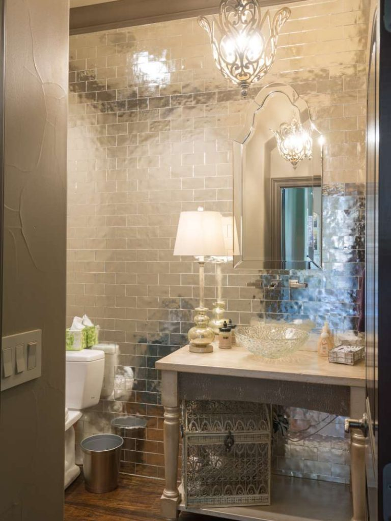 mirrored tile wall in powder bath remodel