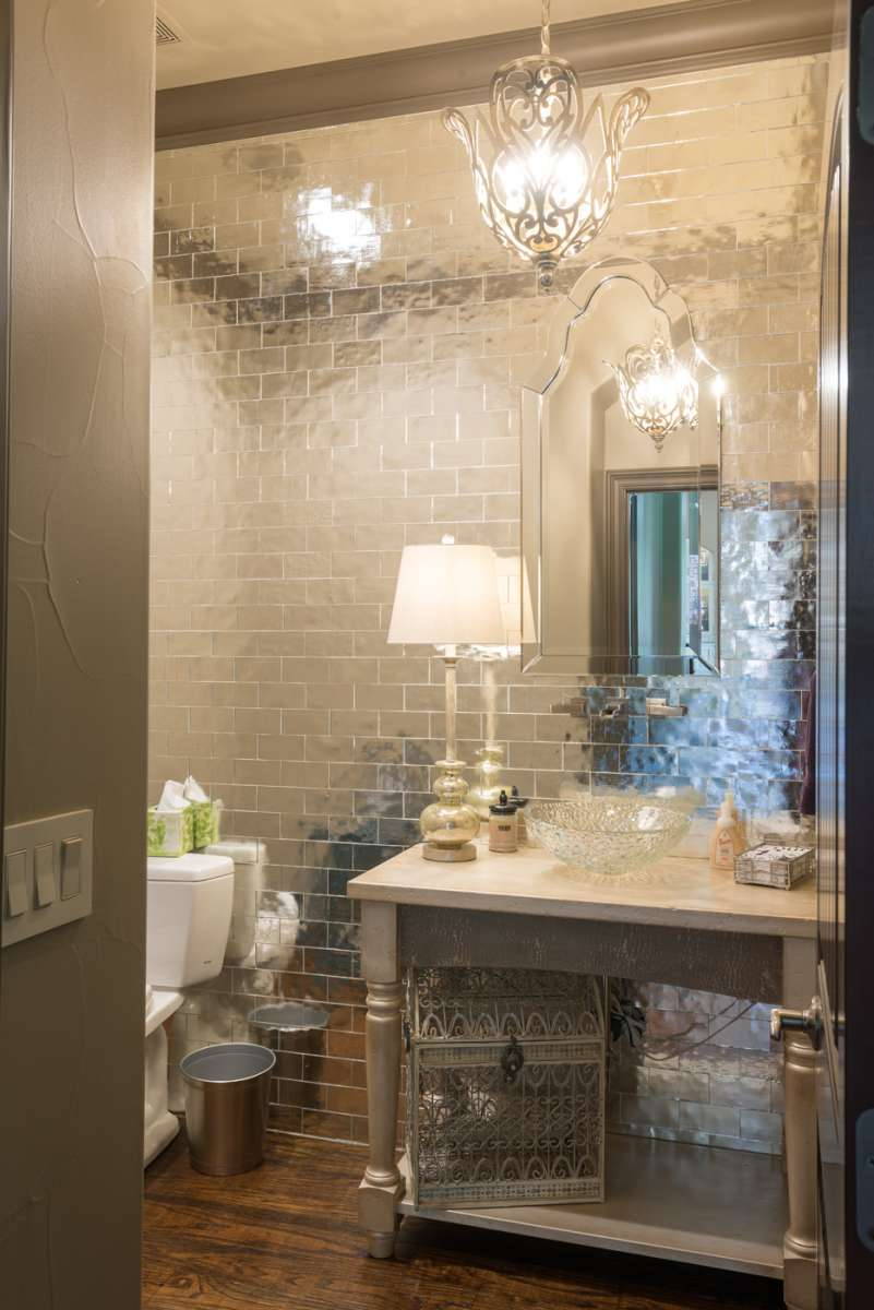 mirrored tile wall in powder bath remodel