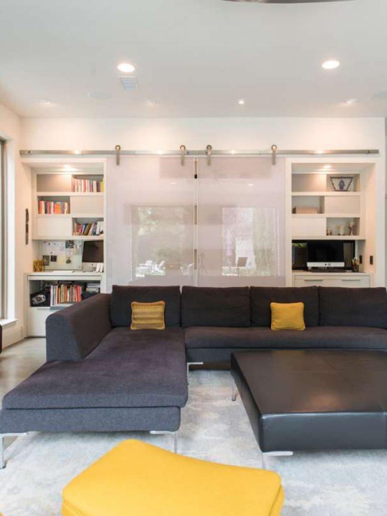 open sliding panels to hide work tops in Northwood Hills family room remodel