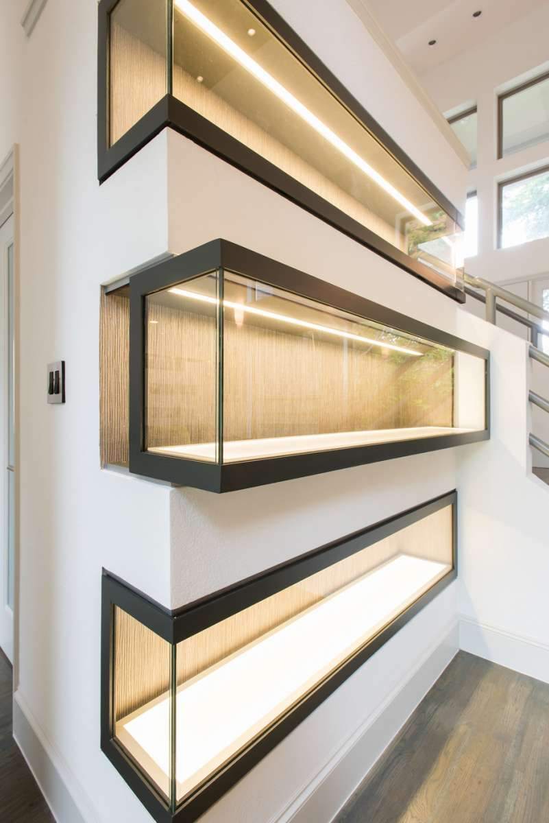 sliding display case with led lighting in Northwood Hills whole house renovation