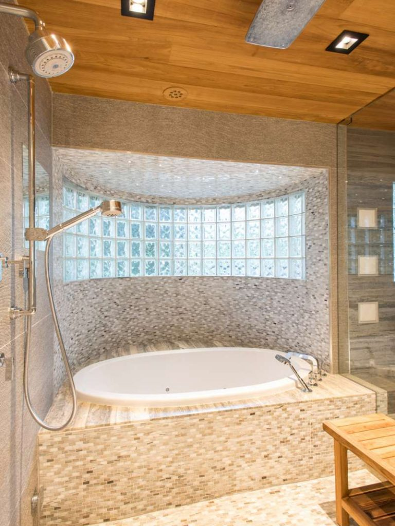 soaking tub in master bathroom of dallas whole home remodel