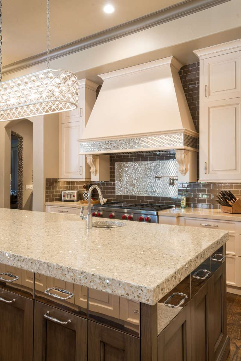 stainless steel tile backsplash at range in Southlake kitchen remodel