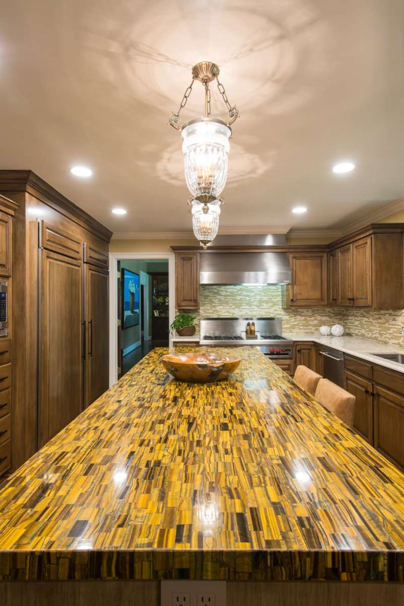 tiger eye countertop on island of preston hollow kitchen remodel
