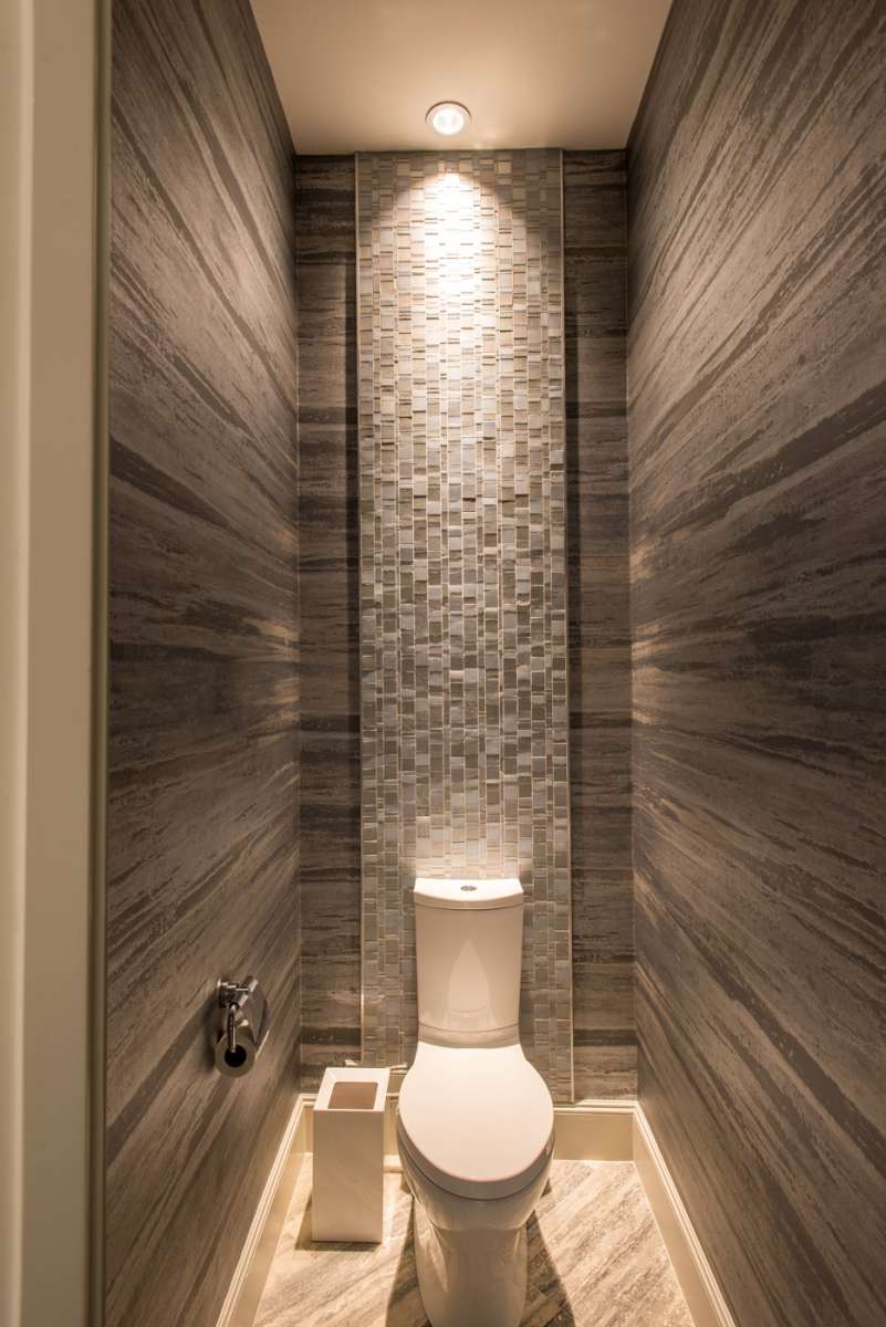 tile behind toilet in master water closet of dallas whole home remodel