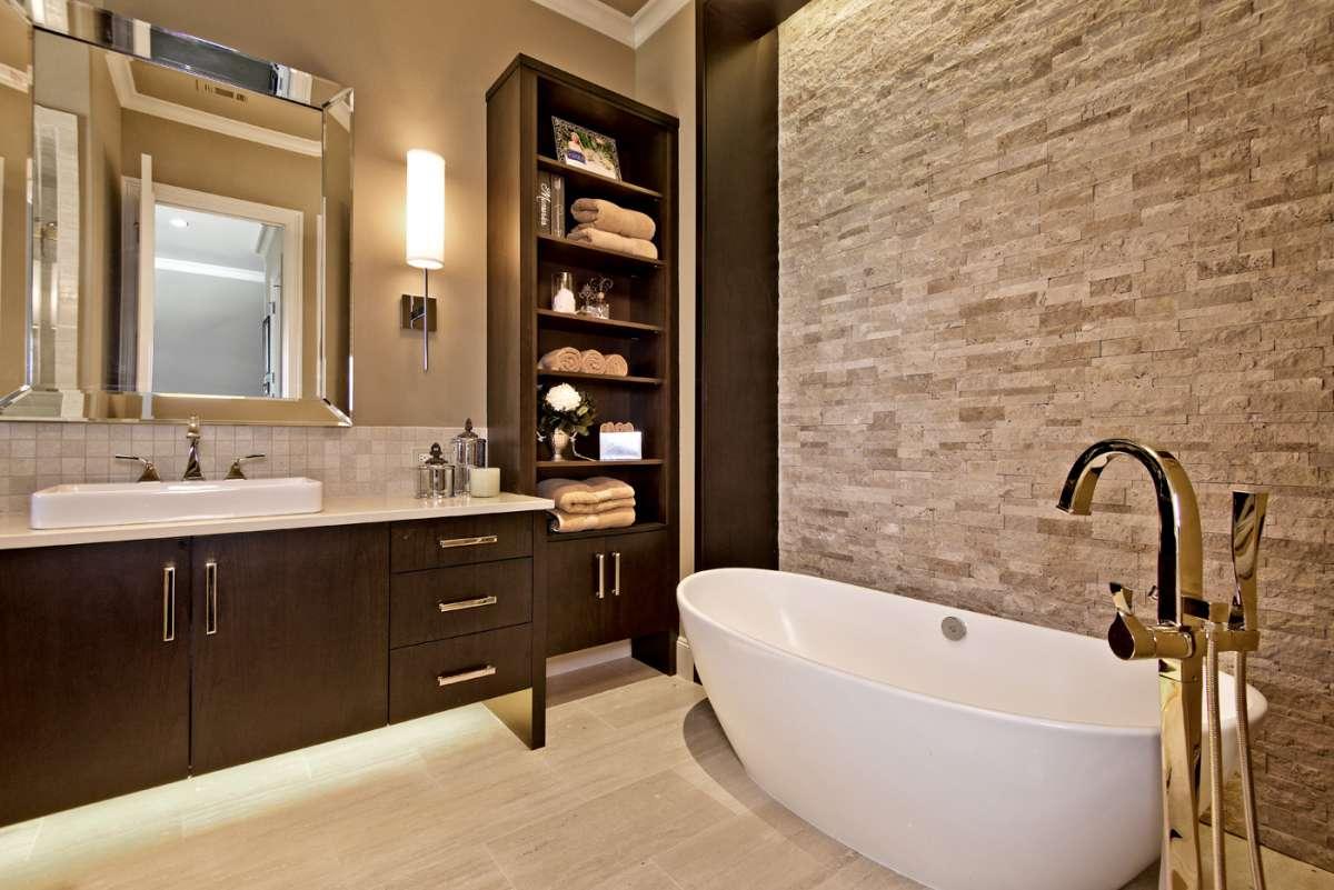 underlit vanity cabinet and freestanding bathtub in southlake bathroom remodel