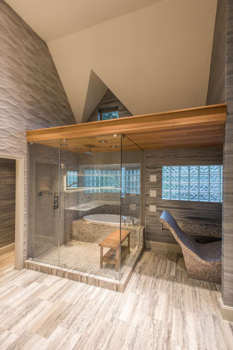 wet room and heated lounger in master bathroom of dallas whole house renovation