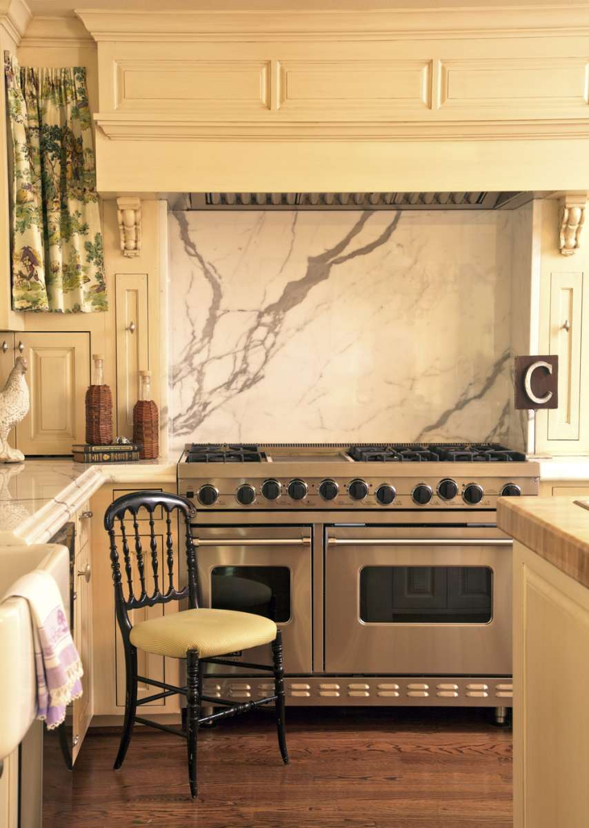 white marble slab backsplash at range of whole house remodel in Richardson