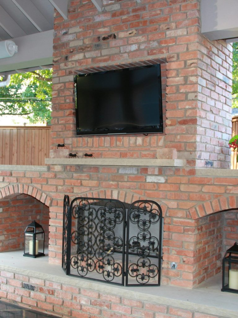 northwood hills outdoor living with TV over fireplace