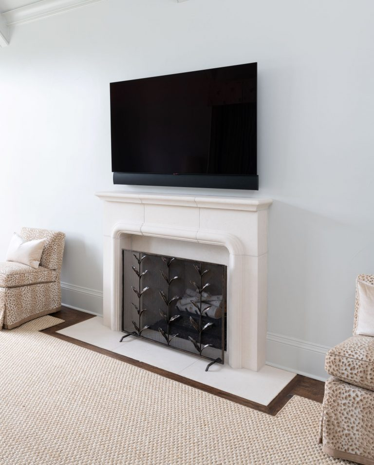 cast stone fireplace mantel in master bedroom remodel